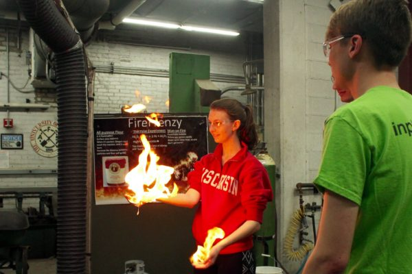Student demonstrates her hand on fire photo